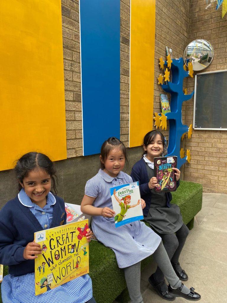 photo of three children enjoying outdoor library